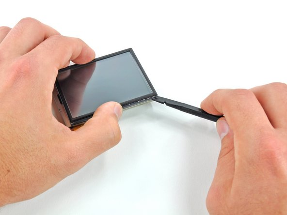 Repeat the above procedure for the remaining two corners to pry the touchscreen off the LCD frame.