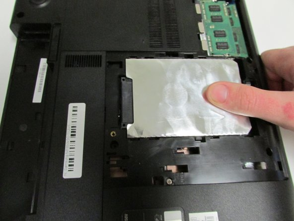 To remove the hard drive, use a small amount of force and slide it out.