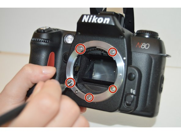 Use a PH00 Phillips screwdriver to remove the five 4.8mm screws on the silver lens mount.