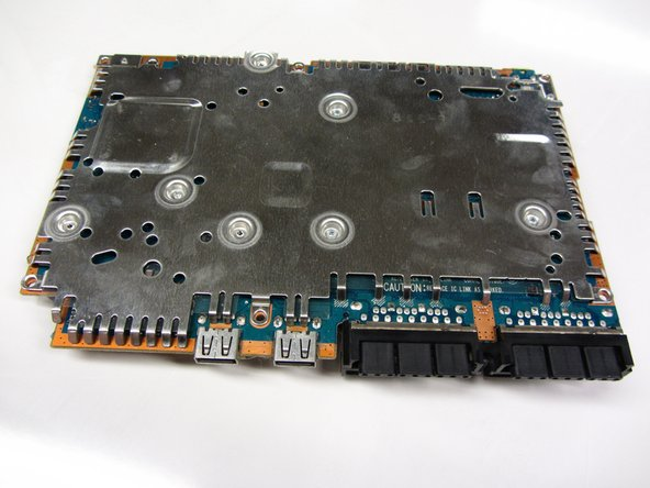 Locate the metal plate that is attached to the back of the motherboard.