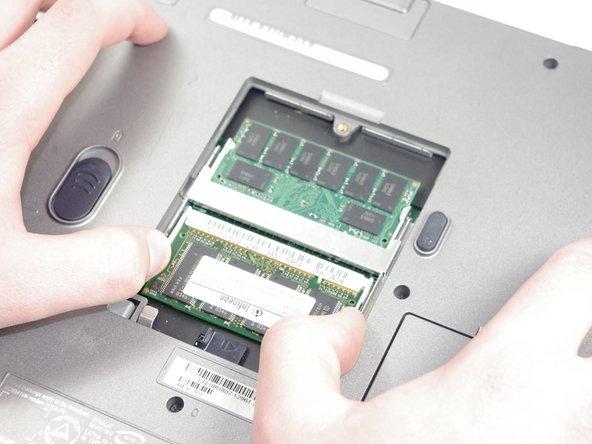 Image 2/3: Push inward until pins can't be seen.