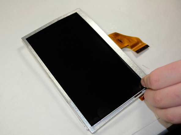 Remove the LCD 5-Point Touch Screen from the display case.