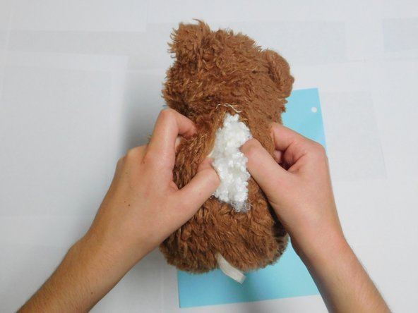 Once the fabric is completely dry, refill the stuffed animal with new stuffing. Spread the stuffing evenly throughout the head, torso, and extremities.