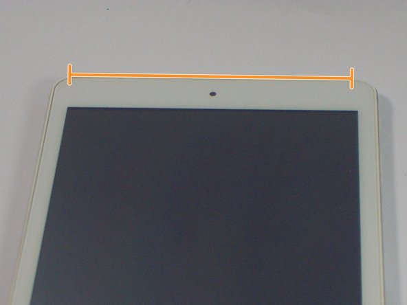 Image 2/2: Do not try to pry apart the top edge on the front side near the front-facing camera.
