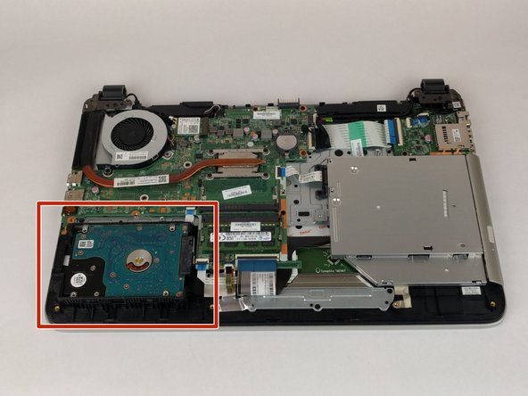 Locate the hard drive and lift up to  give better access to the connector.