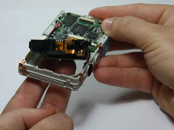 While keeping hold of the lens, flip the entire assembly around.