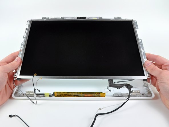 Lift the LCD assembly out of the rear display bezel, minding any cables that may get caught.