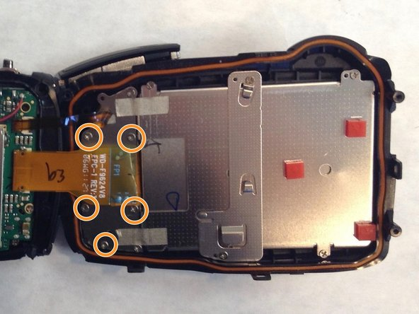 Remove the remaining five 3.0 mm screws which hold the rear case and the control panel together.