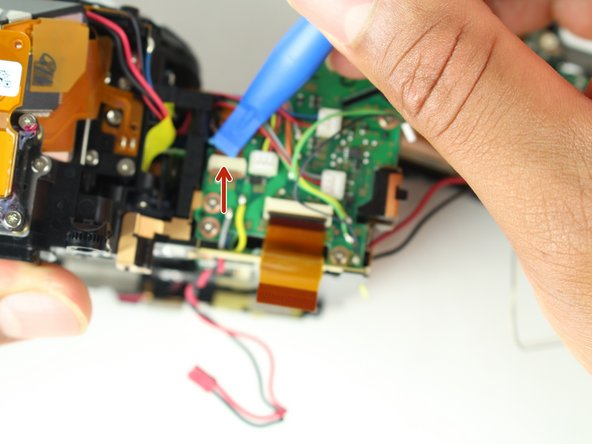 Remove the left front ribbon cable from top right of circuit board.