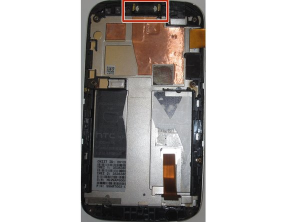 At the top of the phone is the speaker, with two gold coloured connectors.
