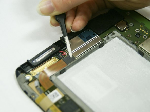 Use the tweezers to pull up the small chip from its receiver.