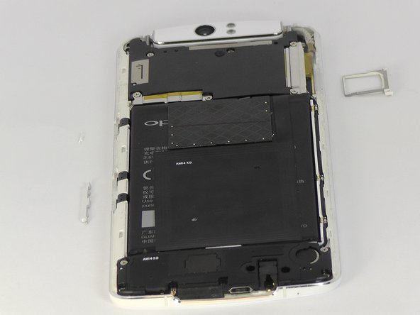 The phone has been rotated in the second picture to show where the buttons are removed from.