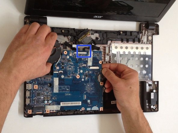 Image 3/3: Carefully remove the Optical drive SATA adapter.