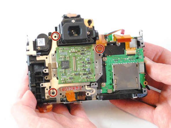 Remove the three remaining silver 3mm Philips  #000 screws from the image sensor.