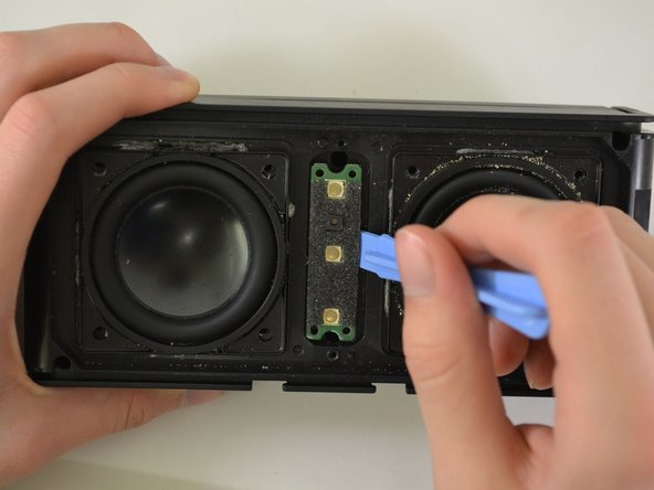 Image 1/1: The button motherboard is connected to a ribbon cable inside the device.