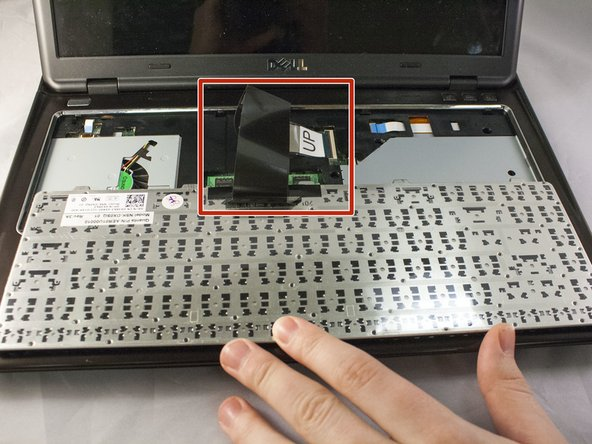 Gently flip keyboard over without damaging the ribbon cable.
