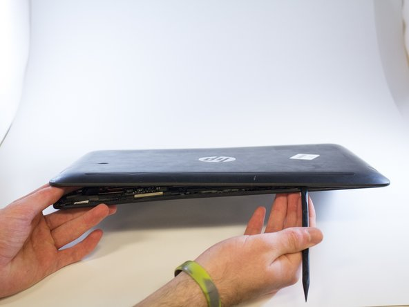 Remove the back of the laptop screen using a black nylon spudger.