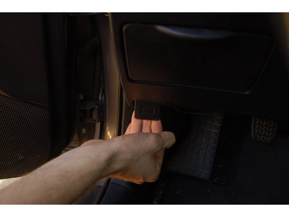 Pull up on the handle and the hood should pop open a small amount.
