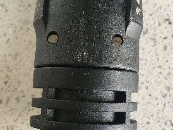 Use punch and hammer to back out metal pins seen here.