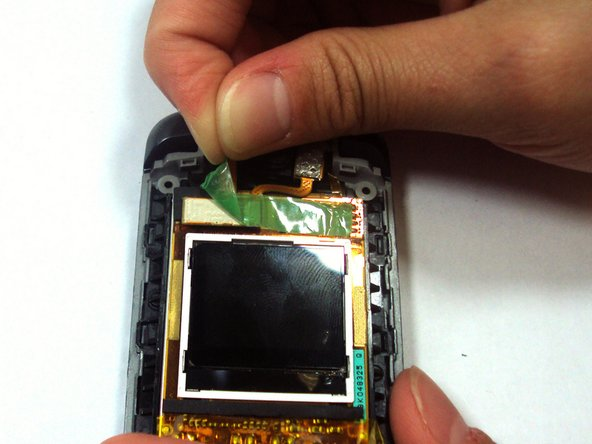 Remove the green tape that covers the end of the yellow flex cable.