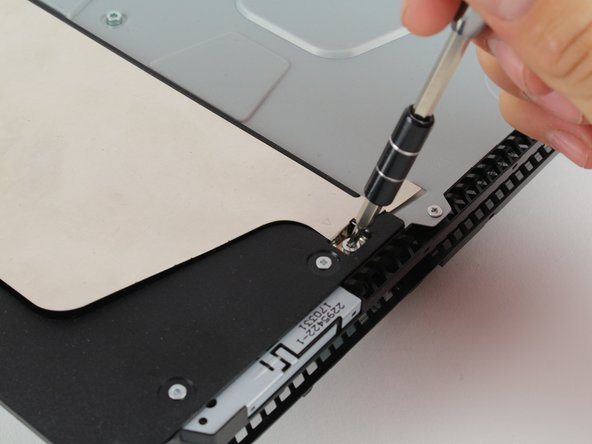 Unscrew and remove the 3.0mm screw using a Phillips #1 screwdriver with a counter-clockwise motion.