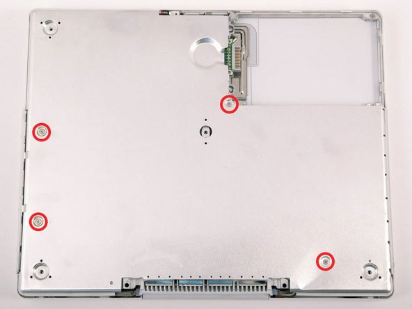 Image 1/1: The two longer screws are along the computer's edge, near the ports.