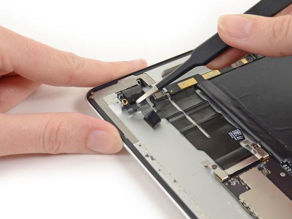 Pull the headphone jack from its port in the rear case and fold out of the way.