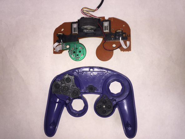 After removing the back of the controller, you can lift the circuit board out of the plastic shell.
