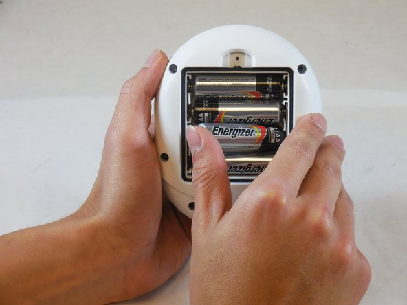Remove and set aside the (4) AA batteries in the battery housing.