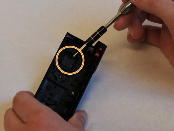 Examine the black plastic zoom slider, on the top cover of the camera