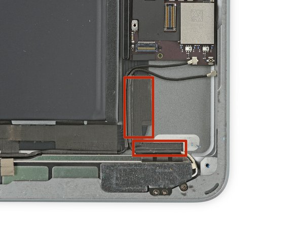 There are two large pieces of tape wrapped around the right antenna cable, securing it to the rear case.