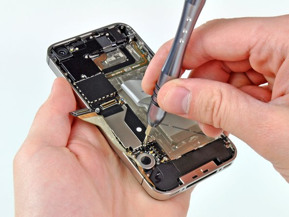 Image 1/3: For enough room to disconnect the Wi-Fi antenna on this phone, the ground finger must first be removed. Apple moved this finger out from beneath the battery connector, making battery replacement that much easier.