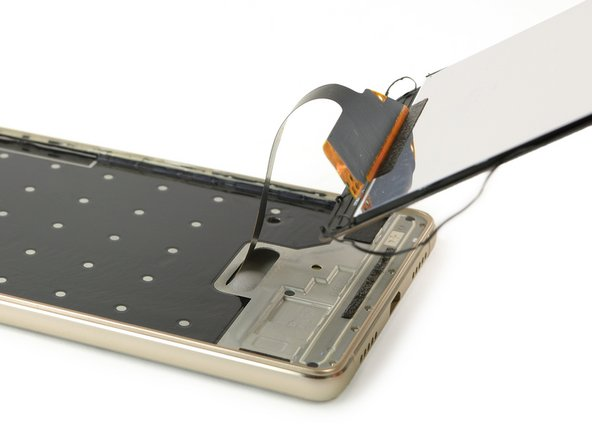 Now you can thread the display flex cable through the gap in the frame.