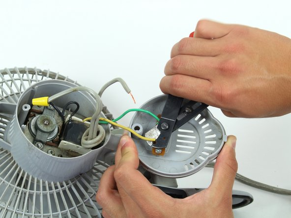 Cut the green and yellow wire as close to the switch connection as possible.