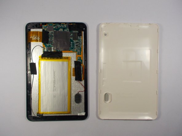 Image 1/1: To replace the cover, simply snap it back in place and re-insert the two screws. Because the speaker is not fully fixed to the interior of the tablet, make sure that it is in the position that will allow it to fit inside the speaker mounting on the cover.