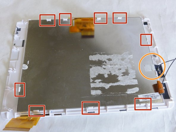 Image 1/1: You may also need to peel back a piece of tape on one side to completely remove the assembly.