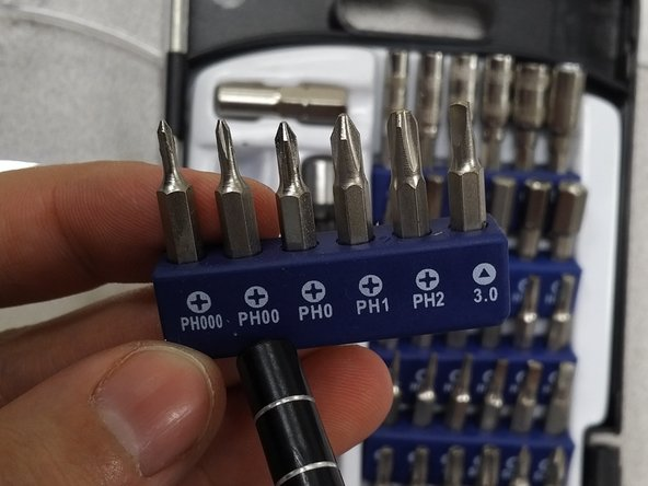There are 4 small screws connecting the motherboard to the frame of the device. Take a PH00 bit screw driver to remove these screws.