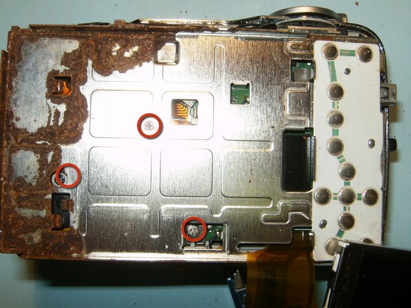 Image 2/3: Remove the 3 screws from the LCD screen holder.