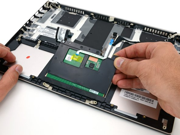 Image 1/3: Like the [guide|9462|MacBook Pro with Retina display|stepid=36209], the touchpad in the Zenbook is located underneath the battery. Unlike the MacBook, though, you can remove this touchpad without destroying said battery.