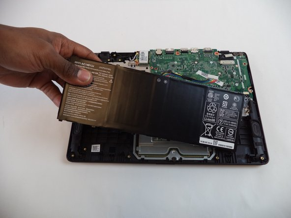 Carefully remove the battery by lifting it out of the casing.