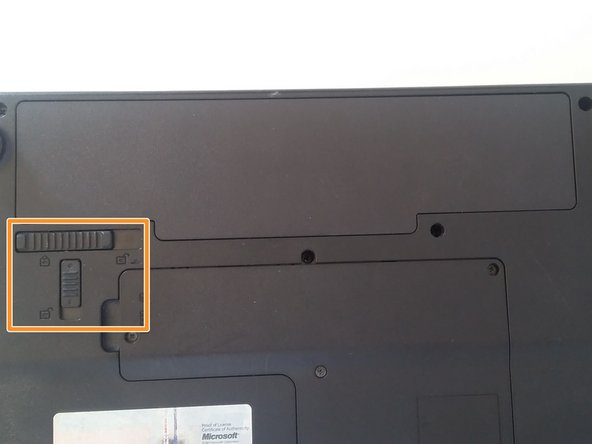 On the left side underneath the battery drawer, you can see two battery lock switches located in the shape of a T.