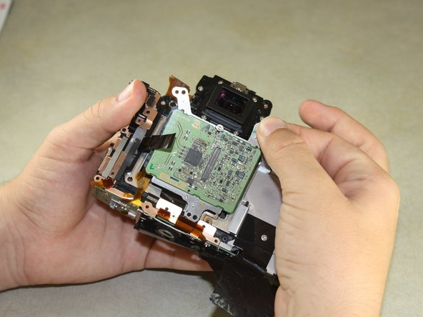 Use your fingers to grip the top of the image sensor and pull it slightly outward.