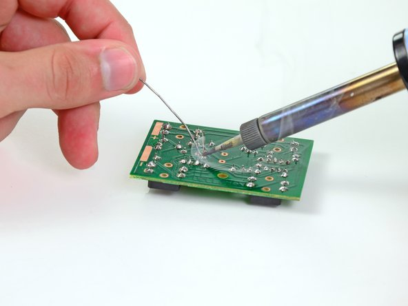 Image 3/3: Solder the three leads to the board and cut the excess off the leads.