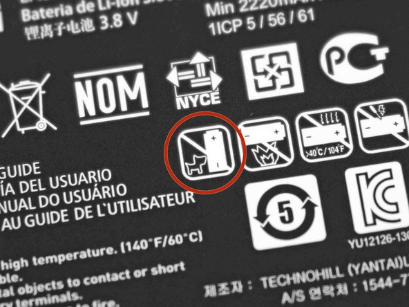 Image 3/3: We're ''pretty'' sure this warning icon indicates that it's unsafe to let pets smaller than this battery anywhere near it.