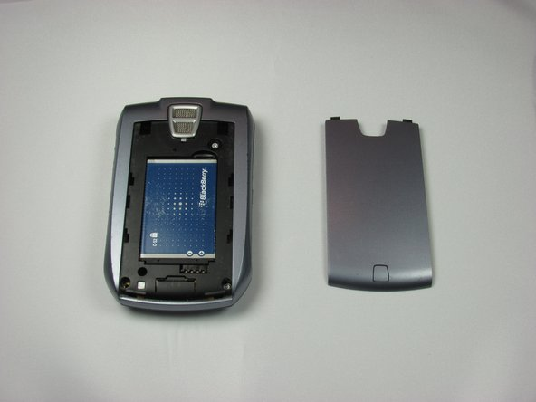 Replace the battery cover by sliding it against the device and snapping it into place.
