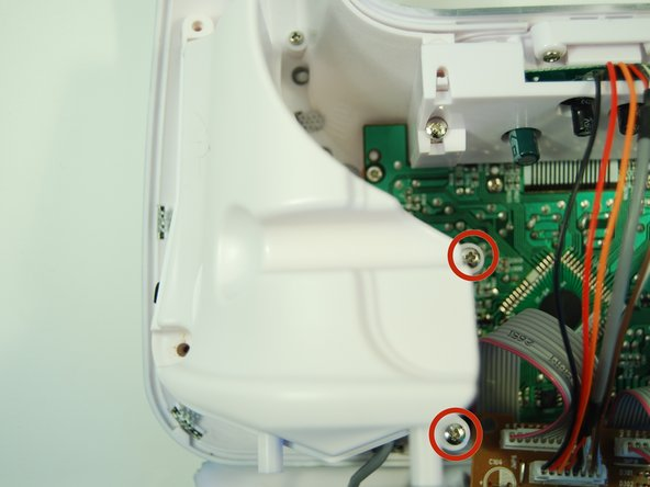 Use a Phillips #1 screwdriver to unscrew the two 8 mm screws on the speaker housing.