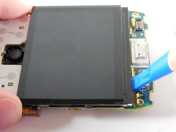 Use a plastic opening tool to pry the LCD display off the board.