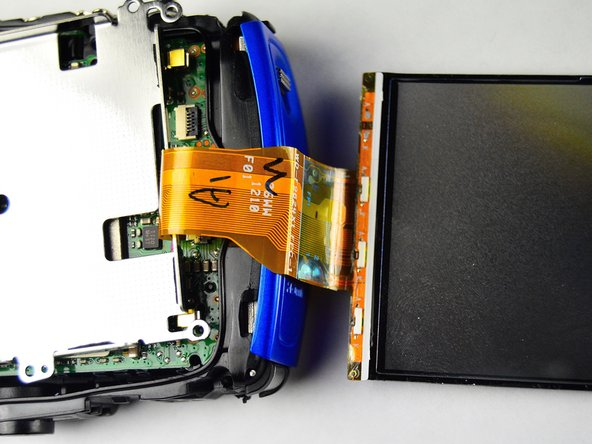 Detach the LCD screen from the motherboard by detaching the orange ribbon.