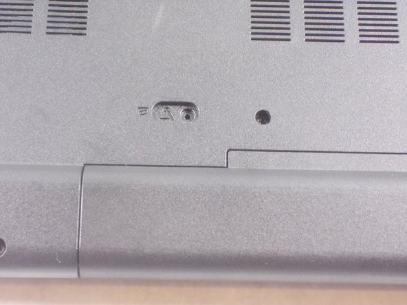 On the back of the laptop, there is a sliding lock. Push the slider and the battery will unlock