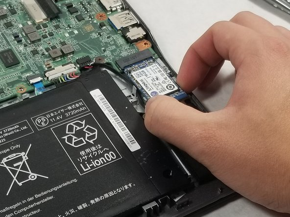 Slide the SSD out of its slot in the motherboard.
